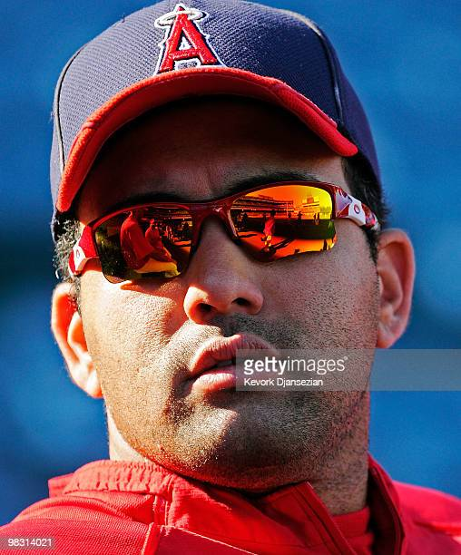 Kendry Morales of the Los Angeles Angels of Anaheim looks at his teammates during batting practice prior to their game against the Minnesota Twins at...