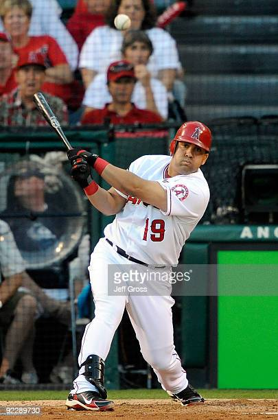 Kendry Morales of the Los Angeles Angels of Anaheim singles to left field during the first inning in Game Five of the ALCS against the New York...