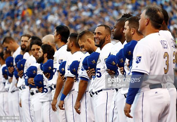 Kendrys Morales of the Kansas City Royals and teammates line the field for the National Anthem and a World Series Champion flag raising ceremony...