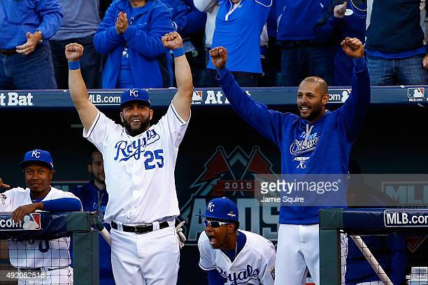 Kendrys Morales of the Kansas City Royals celebrates in the dugout after a challenge from the Royals was reversed to give them the second out in the...