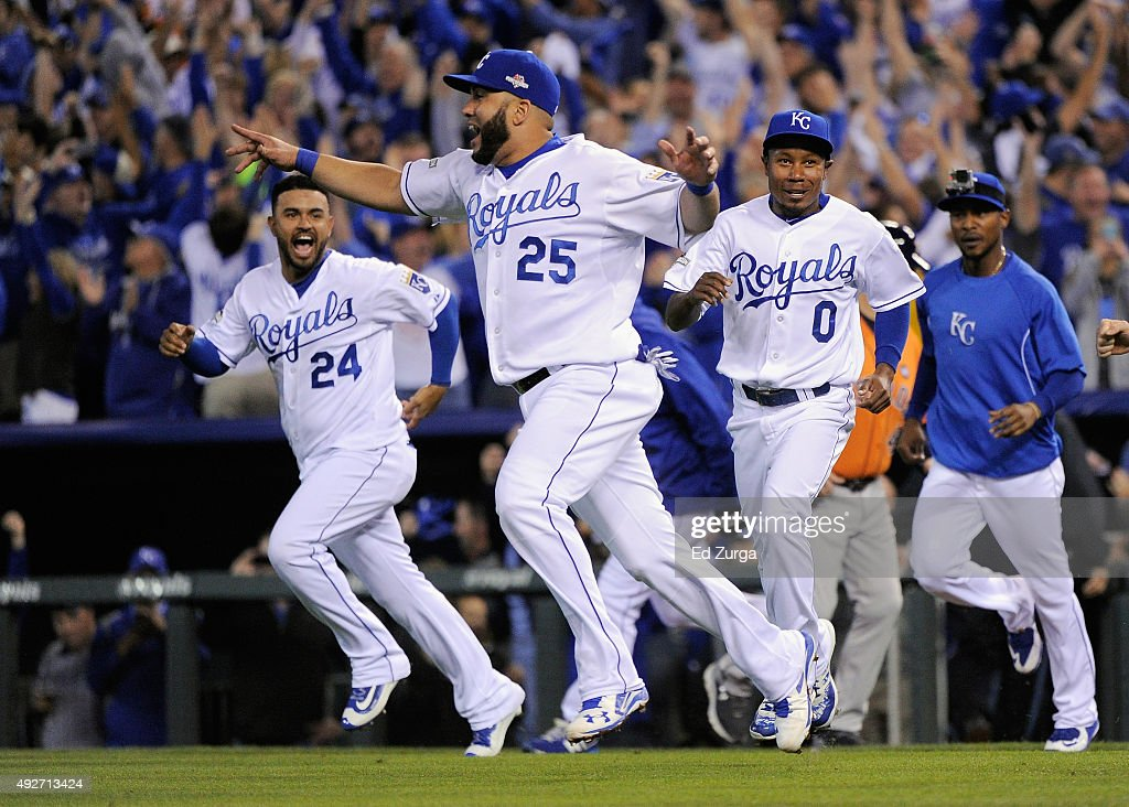 Kendrys Morales #25 of the Kansas City Royals celebrates with teammates after defeating the Houston Astros 7-2 in game five of the American League Divison Series at Kauffman Stadium on October 14, 2015 in Kansas City, Missouri.