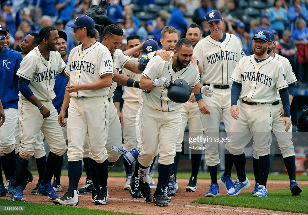 Kendrys Morales #25 of the Kansas City Royals is congratulated by teammates after hitting a two-run walk-off home run in the 13th inning against the Atlanta Braves at Kauffman Stadium on May 15, 2016 in Kansas City, Missouri. The Royals won 4-2.