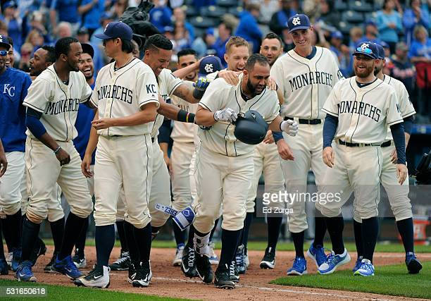 Kendrys Morales of the Kansas City Royals is congratulated by teammates after hitting a tworun walkoff home run in the 13th inning against the...