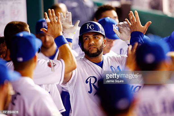 Kendrys Morales of the Kansas City Royals is congratulated in the dugout after hitting a solo home run in the second inning against the Houston...
