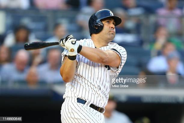 Kendrys Morales of the New York Yankees hits a home run in the second inning against the Tampa Bay Rays at Yankee Stadium on May 17 2019 in New York...