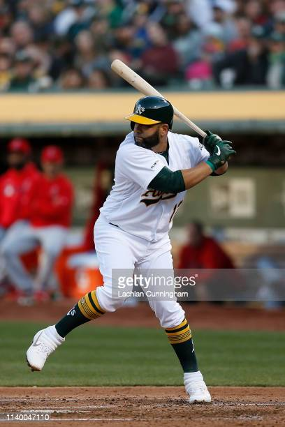 Kendrys Morales of the Oakland Athletics at bat in the bottom of the second inning against the Los Angeles Angels of Anaheim at OaklandAlameda County...
