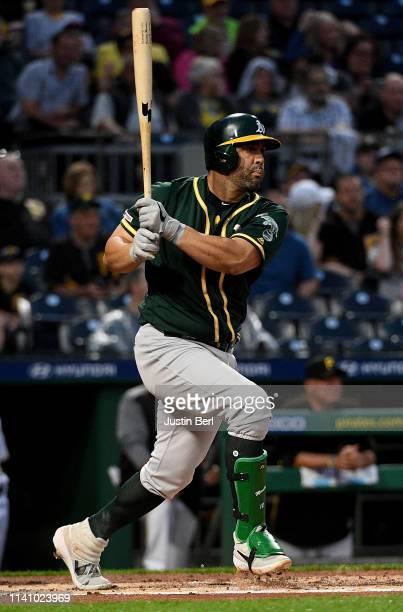 Kendrys Morales of the Oakland Athletics hits an RBI single to center field in the second inning during the game against the Pittsburgh Pirates at...