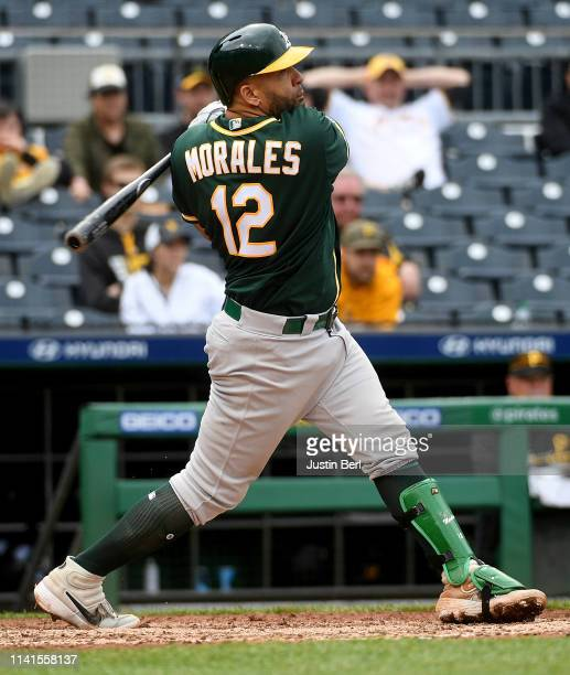 Kendrys Morales of the Oakland Athletics hits an RBI single to center field in the 13th inning during the game against the Pittsburgh Pirates at PNC...
