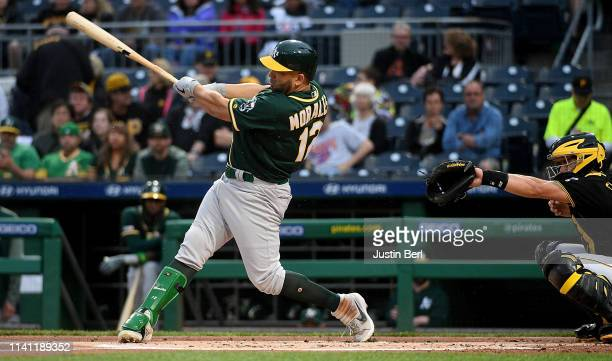 Kendrys Morales of the Oakland Athletics hits an RBI triple to right field in the first inning during the game against the Pittsburgh Pirates at PNC...