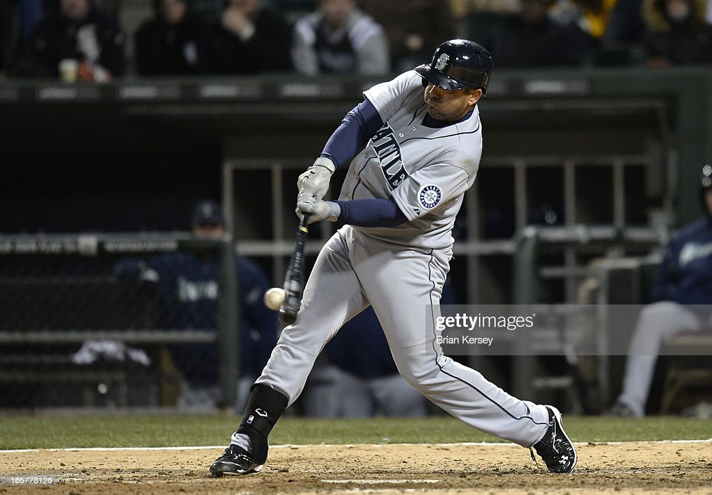 Kendrys Morales #8 of the Seattle Mariners connects on an RBI double scoring teammate Franklin Gutierrez during the tenth inning against the Chicago White Sox on April 5, 2012 at U.S. Cellular Field in Chicago, Illinois. The Mariners won 8-7 in 10 innings.