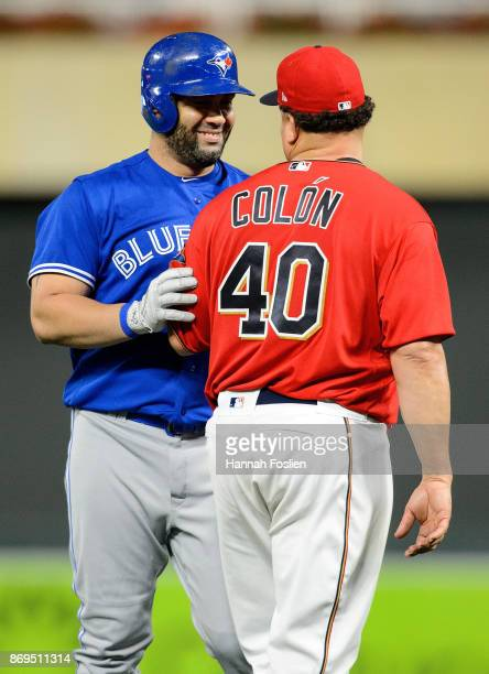 Kendrys Morales of the Toronto Blue Jays and Bartolo Colon of the Minnesota Twins speak during the game on September 15 2017 at Target Field in...