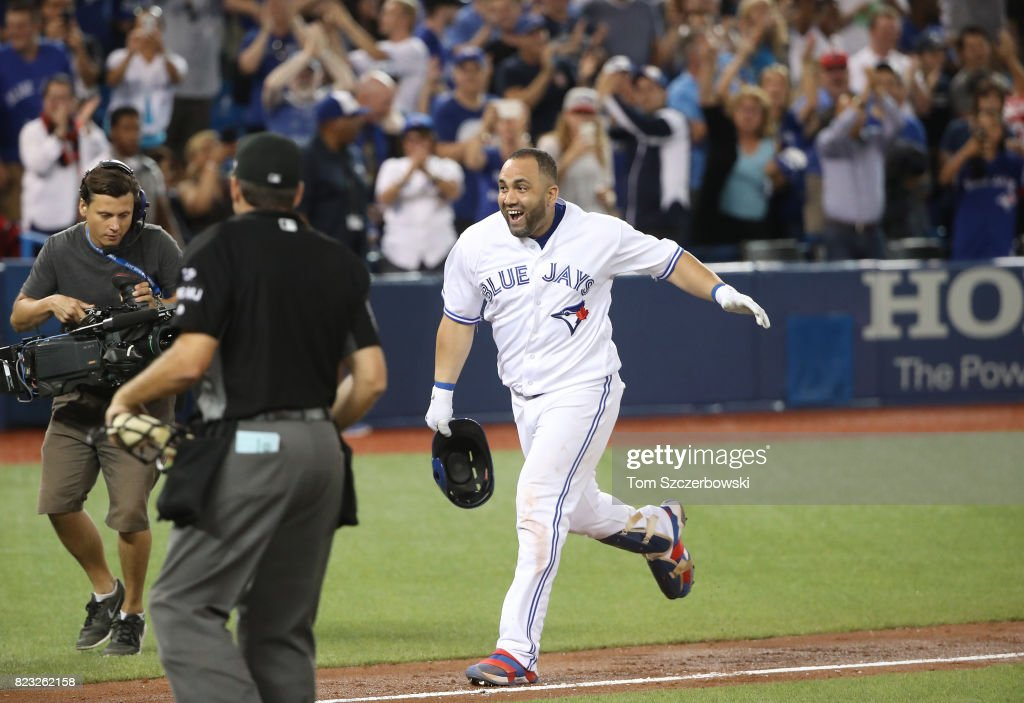 Kendrys Morales #8 of the Toronto Blue Jays celebrates after hitting a game-winning solo home run in the ninth inning during MLB game action against the Oakland Athletics at Rogers Centre on July 26, 2017 in Toronto, Canada.