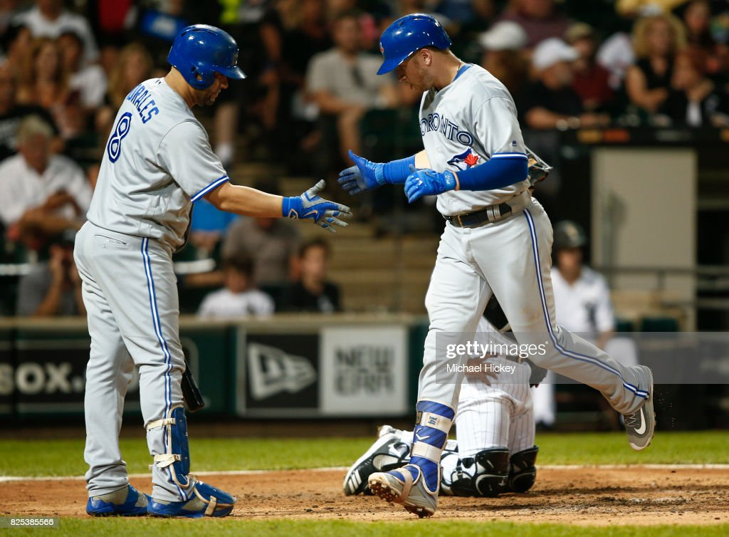 Kendrys Morales #8 of the Toronto Blue Jays congratulates Justin Smoak #14 of the Toronto Blue Jays after a two run homer in the fifth inning against the Chicago White Sox at Guaranteed Rate Field on August 1, 2017 in Chicago, Illinois.