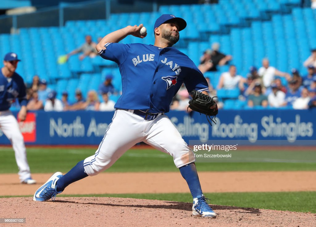 Kendrys Morales #8 of the Toronto Blue Jays delivers a pitch in the ninth inning during MLB game action against the Oakland Athletics at Rogers Centre on May 20, 2018 in Toronto, Canada.