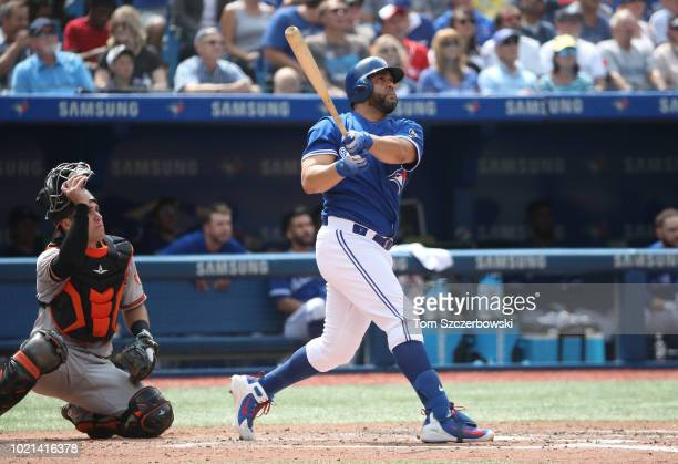 Kendrys Morales of the Toronto Blue Jays hits a solo home run in the seventh inning during MLB game action against the Baltimore Orioles at Rogers...