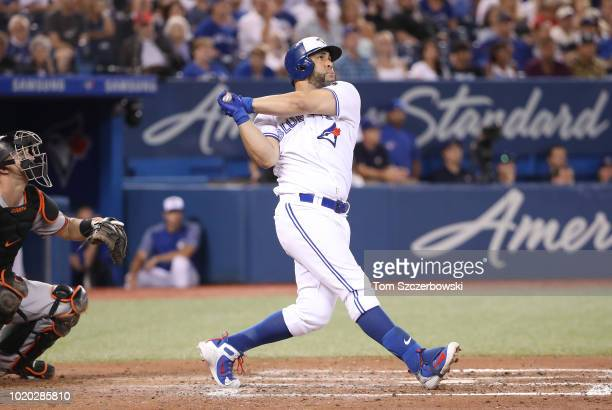 Kendrys Morales of the Toronto Blue Jays hits a threerun home run in the fifth inning during MLB game action against the Baltimore Orioles at Rogers...