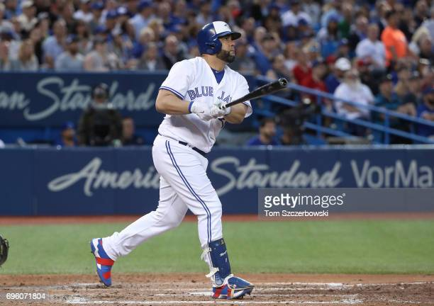 Kendrys Morales of the Toronto Blue Jays hits a threerun home run in the fifth inning during MLB game action against the Tampa Bay Rays at Rogers...