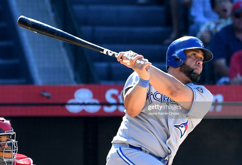 Kendrys Morales #8 of the Toronto Blue Jays hits the game winning home run in the tenth inning against the Los Angeles Angels of Anaheim at Angel Stadium on June 24, 2018 in Anaheim, California.