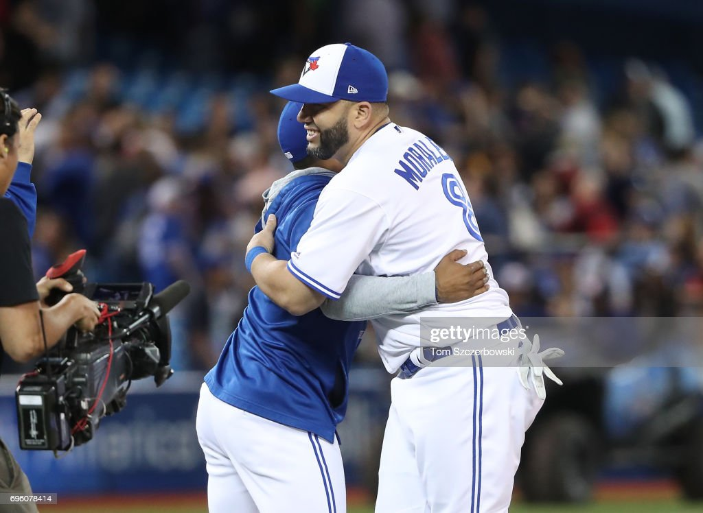 Kendrys Morales #8 of the Toronto Blue Jays is congratulated on their victory by Marcus Stroman #6 during MLB game action against the Tampa Bay Rays at Rogers Centre on June 14, 2017 in Toronto, Canada.
