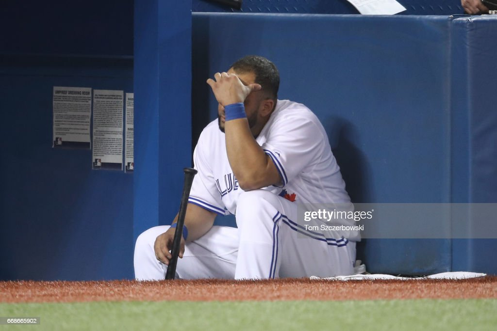 Kendrys Morales #8 of the Toronto Blue Jays looks on from the top step of the dugout during MLB game action against the Baltimore Orioles at Rogers Centre on April 14, 2017 in Toronto, Canada.