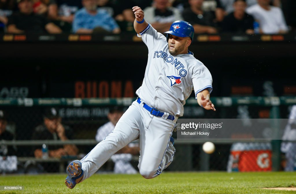 Kendrys Morales #8 of the Toronto Blue Jays slides into home during the seventh inning against the Chicago White Sox at Guaranteed Rate Field on August 1, 2017 in Chicago, Illinois.