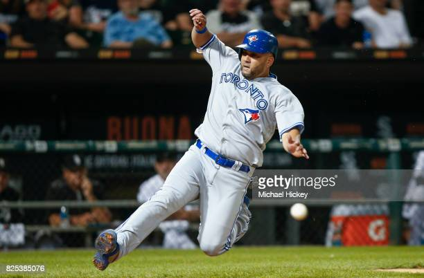 Kendrys Morales of the Toronto Blue Jays slides into home during the seventh inning against the Chicago White Sox at Guaranteed Rate Field on August...