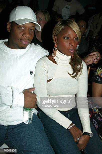 Kendu Isaacs and Mary J Blige during Olympus Fashion Week Spring 2005 Baby Phat Backstage and Front Row at Skylight Studio in New York City New York...