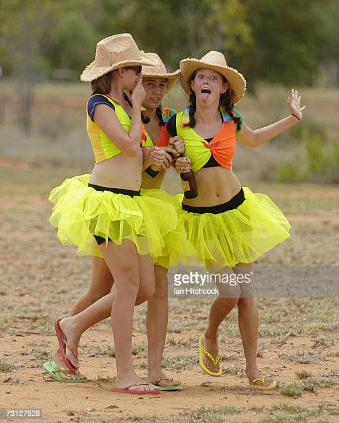 Kendyll Currin Kristen Paterson and Rebecca Moxham who dubbed themselves 'Tuggas Beer Tarts' bring beers out to competitiors during the Goldfield...