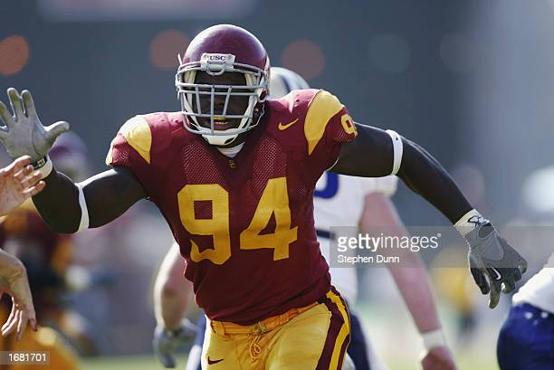 Kenechi Udeze of the USC Trojans rushes the quarterback during the Pac10 Conference football game against the Washington Huskies at the Los Angeles...