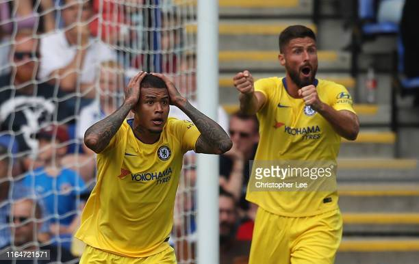 Kenedy and Olivier Giroud of Chelsea appeal for a hand ball during the Pre-Season Friendly match between Reading and Chelsea at Madejski Stadium on...