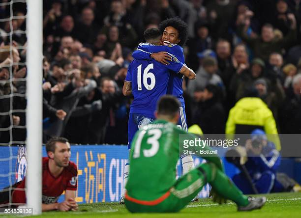 Kenedy and Willian of Chelsea celebrate their third goal scored by Gareth McAuley of West Bromwich Albion during the Barclays Premier League match...