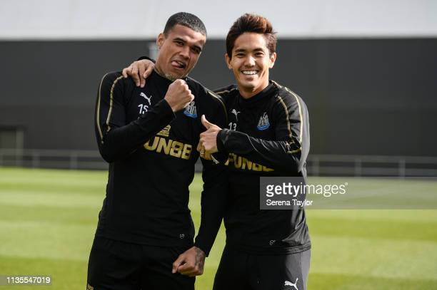 Kenedy and Yoshinori Muto smile for the camera during the Newcastle United Training Session at the Newcastle United Training Centre on March 13 2019...