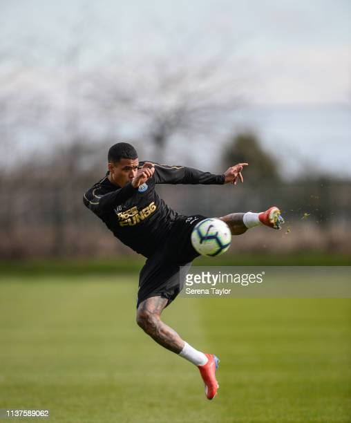 Kenedy jumps in the air to control the ball during the Newcastle United Training Session at the Newcastle United Training Centre on March 22 2019 in...