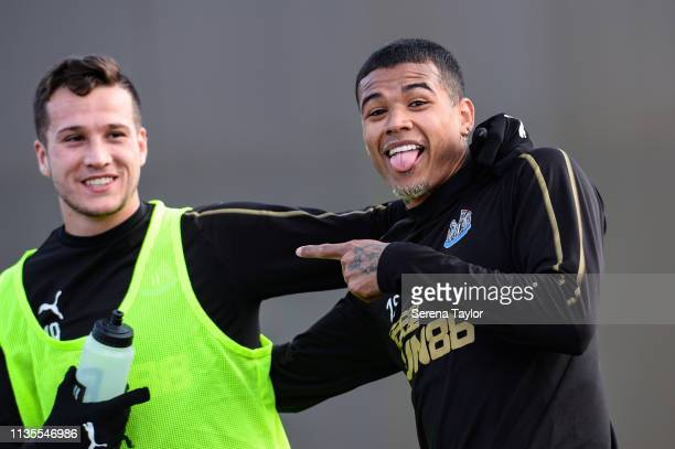 Kenedy laughs with Javier Manquillo during the Newcastle United Training Session at the Newcastle United Training Centre on March 13, 2019 in...