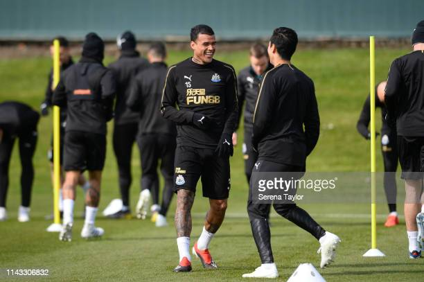 Kenedy laughs with Yoshinori Muto during the Newcastle United Training Session at Newcastle United Training Centre on April 17 2019 in Newcastle upon...