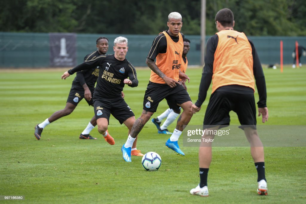 Kenedy (C) looks to control the ball whilst Matt Ritchie; (L) looks to challenge during the Newcastle United Training session at Carton House on July 12, 2018, in Kildare, Ireland.