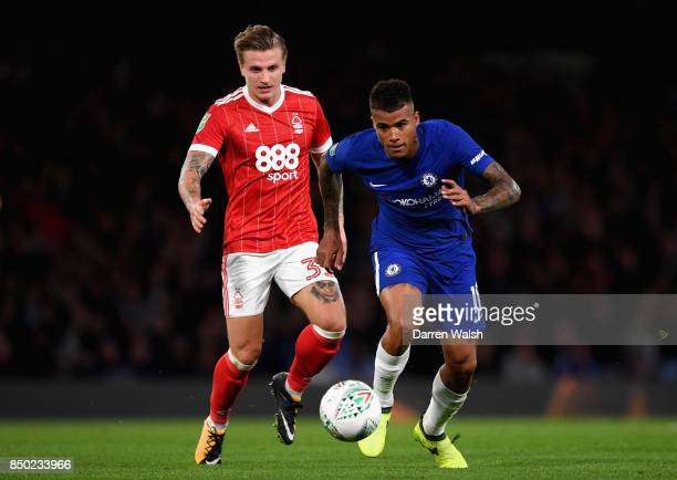 Kenedy of Chelsea and Jason Cummings of Nottingham Forest in action during the Carabao Cup Third Round match between Chelsea and Nottingham Forest at...