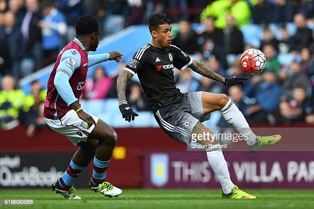 Kenedy of Chelsea and Micah Richards of Aston Villa compete for the ball during the Barclays Premier League match between Aston Villa and Chelsea at...