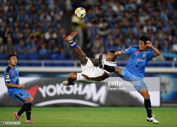 Kenedy of Chelsea attempts an overhead kick as he is challenged by Hidemasa Morita of Kawasaki Frontale during the preseason friendly match between...