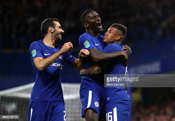 Kenedy of Chelsea celebrates scoring his sides first goal with Davide Zappacosta of Chelsea and Antonio Rudiger of Chelsea during the Carabao Cup...