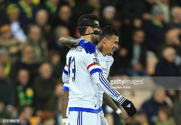 Kenedy of Chelsea celebrates scoring his team's first goal with his team mate Diego Costa during the Barclays Premier League match between Norwich...
