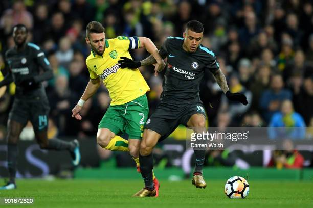 Kenedy of Chelsea is tackled by Ivo Pinto of Norwich City during The Emirates FA Cup Third Round match between Norwich City and Chelsea at Carrow...