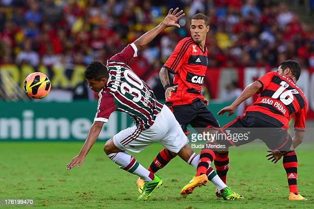 Kenedy of Fluminense struggles for the ball during a match between Fluminense and Flamengo as part of Brazilian Championship 2013 at Maracana Stadium...