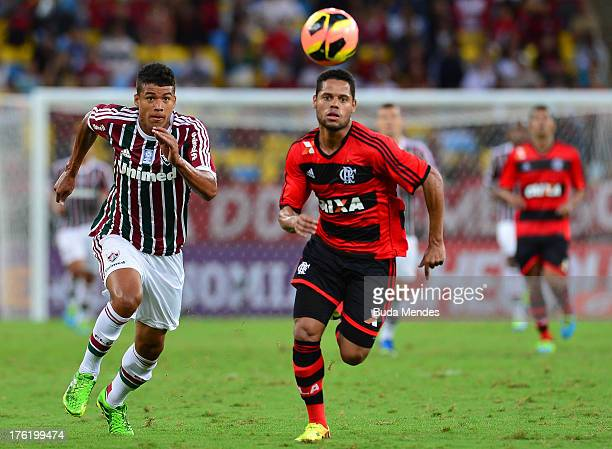 Kenedy of Fluminense struggles for the ball with Joao Paulo of Flamengo during a match between Fluminense and Flamengo as part of Brazilian...
