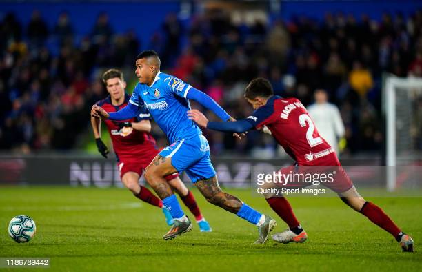 Kenedy of Getafe CF battle for the ball with Nacho Vidal of CA Osasuna during the Liga match between Getafe CF and CA Osasuna at Coliseum Alfonso...