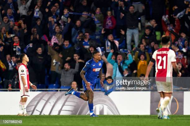 Kenedy of Getafe CF celebrates after scoring his team's second goal during the UEFA Europa League round of 32 first leg match between Getafe CF and...