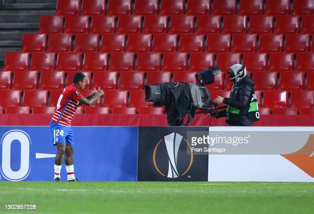 Kenedy of Granada CF celebrates after scoring their sides second goal during the UEFA Europa League Round of 32 match between Granada CF and SSC...