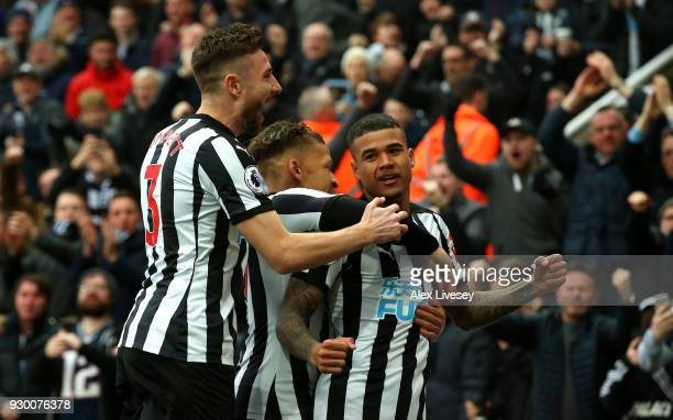 Kenedy of Newcastle United celebrates with teammates after scoring his sides first goal during the Premier League match between Newcastle United and...