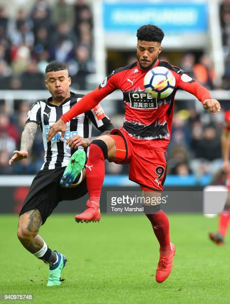 Kenedy of Newcastle United challenges Elias Kachunga of Huddersfield Town during the Premier League match between Newcastle United and Huddersfield...