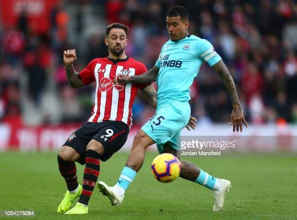 Kenedy of Newcastle United is challenged by Danny Ings of Southampton during the Premier League match between Southampton FC and Newcastle United at...